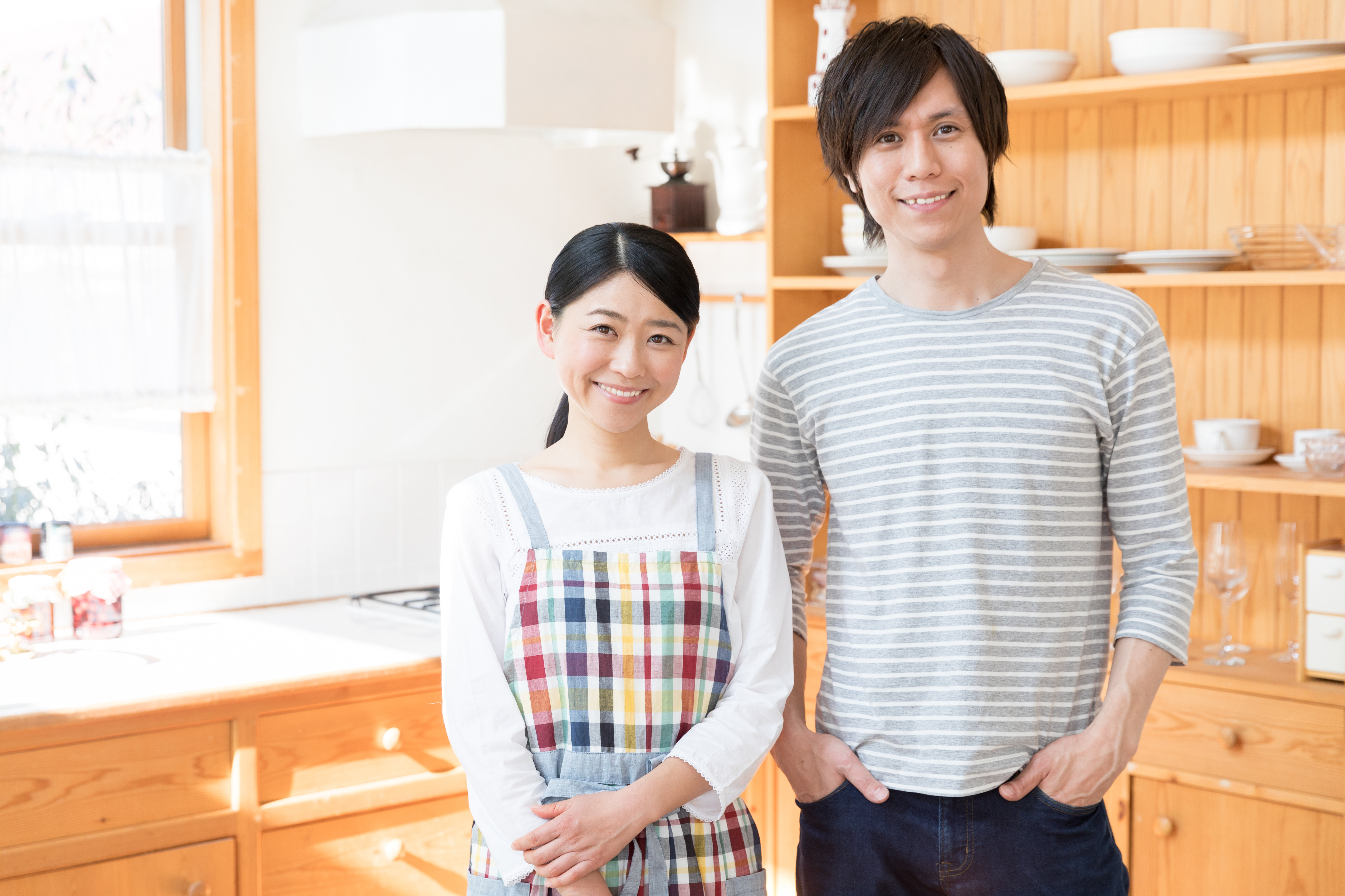 portrait of young asian couple in the kitchen